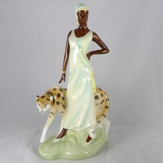 Rare Royal Doulton porcelain figurine of Charlotte.  An art deco style sculpture of a very elegant African woman out walking with her cheetah.  One of the Charleston Series figurines. For more information on this figurine, please visi...