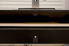 Materials: desk, wood boards, hobby hinges and magnetic latch from Home Depot…
