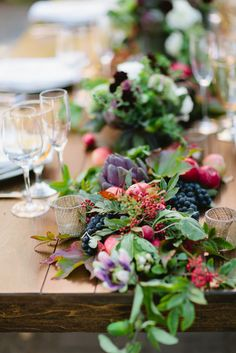 Gorgeous farm table wedding centerpiece. Beautiful for a fall wedding. Rustic and earthy.
