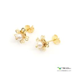 Flower shaped stud earrings made of pearl beads and bead caps hammered to give them the shape of petals