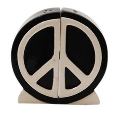This peace sign salt and pepper shaker set is bound to make any fan of the hippie movement happy. 1960s-style ceramic salt and pepper set looks great in any retro kitchen! Measures: 1.5W x 4H inches.