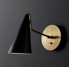 RH Modern's Clemente Sconce:With its pared-down lines and distinctive cone-shaped shade, our collection from American designer Aerin recalls Italian modernist lighting of the 1950s. An understated backplate supports a pivoting arm that allows you to direct light precisely where you need it.