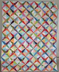 scrappy value quilt  Tutorial here:  http://www.squaresandtriangles.com/ez-dresden-challenge-tutorial