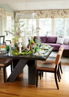Love the Dining room table, floors and sofa with rug, forget the wall paper
