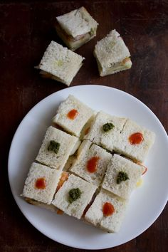 Vegitarian sandwich; do raw or grilled veggies and different sauces/chutnies like green chutney, tamarind chutney and ketchup etc