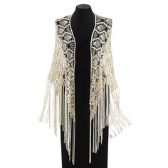 "Boho Macrame Shawl | Fringe! It's a macramé revival! Popularized in the '60s, the art of knotted, fringed yarn returns as a graceful, versatile, Boho-chic shawl. 100% rayon. Hand washable. Imported. Color: Crème. One size fits all. 72"" x 25""."