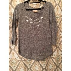 Long sleeve Hollister shirt. This Hollister shirt is cozy with embellishment at the top. Hollister Tops Tees - Long Sleeve