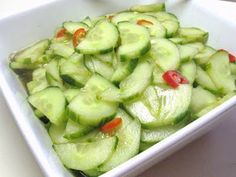 Spicy Asian Cucumber Salad: 3/4 cup seasoned rice vinegar, 1/4 cup water  1 tablespoon sugar, 1 tablespoon lite soy sauce, 1 teaspoon salt, 1 teaspoon sesame oil, 2 large cucumbers, peeled and sliced, 2 tablespoons sesame seeds, toasted, 2 fresh chili peppers, sliced (optional) *In a large bowl, stir together rice vinegar, water, sugar, soy sauce, salt, and sesame oil. Add cucumbers, tossing to coat. Cover and chill 1 hour. Add sesame seeds and peppers, and toss; serve immediately.