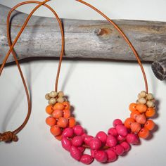 Colorful paper bead rings on an adjustable leather cord. Choose from Blue Ombre, Purple Ombre, Pink Sorbet, Orange Sorbet, and Sunset. Mouse over featured image and scroll to view color combinations. $25 https://squareup.com/market/friday-market-beads-llc