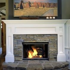 Other possible way of revamping our fireplace... Stacked stone with traditional mantel facade: