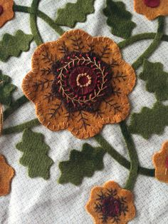 Love the embroidery and fall colors. By Lisa Bongean