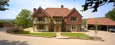 Stubblefield - Manor house frontage with jettied gable to left hand side and brick and tile hung wing to the left hand side. Oak Framed Buildings, Oak Frame House, New Home Designs, Traditional House, Cladding, Interior Architecture, Building A House, Villa, New Homes