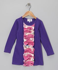 Delightfully decorated with a row of pattern-packed ruffles, this fabulous frock is a perfect fit for any occasion. Made from a stretchy cotton blend, it'll keep girls comfy no matter the level of play.