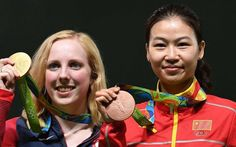 USA's gold medallist Virginia Thrasher (C) poses on the podium with China's silver medal winner Du Li (L) and China's bronze medallist Yi Siling during the medal ceremony for the women's 10m air rifle shooting event at the Rio 2016 Olympic Games. Photo: AFP