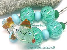 GREEN FISH...handmade lampwork beads by by AnastasiaBEADS on Etsy