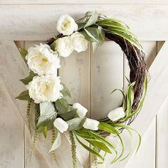 Keep things interesting with style that's slightly off center. Our asymmetric wreath, crafted with a rustic twig base and a two-toned palette of green of white, is a great place to start.