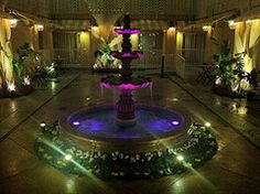 Recently renovated courtyard fountain at night