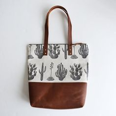 CACTUS CARRY-ALL BAG - Boxhill The classic cactus design is screenprinted by-hand in a non-toxic, water-based black ink. Includes a solid brass swivel snap clip that may be used to attach your keys or a small pouch. Accessoires Divers, Carry All Bag, Cute Bags, A Boutique, Fashion Bags, Leather Bag, Brown Leather, Screen Printing, Purses And Bags