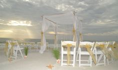 Florida beach wedding style by Suncoast Weddings ... Gold accents and a circle of chairs to surround the happy couple with love as they take their vows