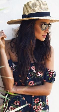 Who made Shay Mitchell's black floral print romper?