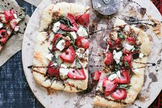 A gourmet strawberry basil pizza consisting of strawberries, fresh basil, goat cheese and a balsamic glaze.