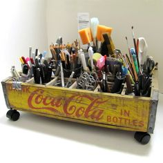 I can't decide what to do with my coke crate... Adorable organizer with wheels...