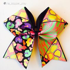 """Cheer bow of the day. by @the_copper_pixy """"Neon animal printed grosgrain cheer bow."""" #cheerbow#cheerbows#animalprints#zebra#leopard#cheetah#neon#hairbow#hairbows#girl#cheerleader#school#highschool"""