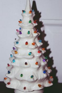 vintage ceramic christmas tree lights from inside by white cord on off switch