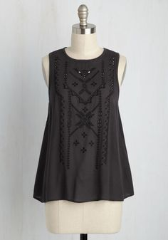 You want to rock something special for the upcoming concert, and this deep charcoal tank top is exactly it. The black, geometric accents embroidered down its woven front - touched with petite cutouts - offer the perfect amount of edge, while its knit, keyhole-enclosed back take your comfort to the next level!
