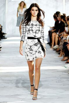 Doing it all over again: The following season, Kendall wore white lace in Diane von Furstenberg's spring 2015 show at NYFW