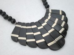 VINTAGE 1940s NECKLACE of OX BONE & SILVER | From a unique collection of vintage beaded necklaces at http://www.1stdibs.com/jewelry/necklaces/beaded-necklaces/