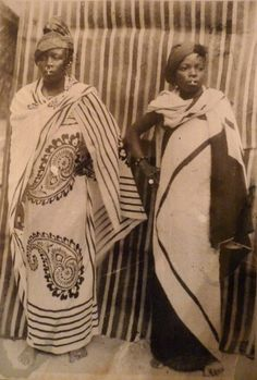 """Mozambique:  """"Two Makua women of northern Mozambique in the late 19th century wearing head scarves known as lenço and wrap around cloth capulana."""