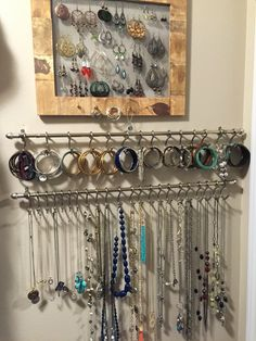 Made the earring holder from a frame and wire mesh stapled to the back. The bracelet and necklace holders are curtain rods with shower curtain hooks. :)