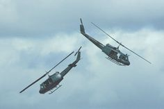Two of No.3 Squadron's Iroquois helicopters perform an aerial pas de deux.