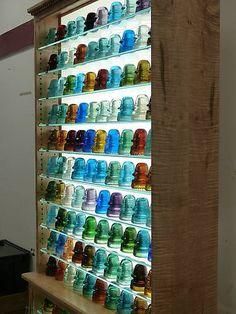 What are people thinking when they buy these at auction?  Now we know!  Colorful glass insulators.  They saw something beautiful we didn't see.