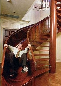 When I was like 8 years old, I had to draw up a sketch idea for what I wanted my future house to look like, a loft upstairs with a hammock bed, a fireman's pole, and a spiral staircase just like this. Stair Slide, Stairs With Slide, Stairway To Heaven, Staircase Design, House Staircase, Staircase Storage, Staircase Ideas, Grand Staircase, Home Decor Trends