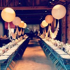 Giant baloon at each table, tied together table-to-table with tassels