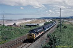 North Wales Loch InterCity Mainline liveried Class 37/4 37407 'Loch Long' heads along the North Wales coast near Llanddulas while working the 10:15 Blackpool North to Holyhead service. All images on this site are exclusive property and may not be copied, downloaded, reproduced, transmitted, manipulated or used in any way without expressed written permission of the photographer. All rights reserved – Copyright Don Gatehouse