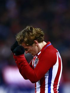 Antoine Griezmann (R) of Atletico de Madrid reacts as he fail to score during the Copa del Rey semi-final first leg match between Club Atletico de Madrid and FC Barcelona at Estadio Vicente Calderon on February 1, 2017 in Madrid, Spain.