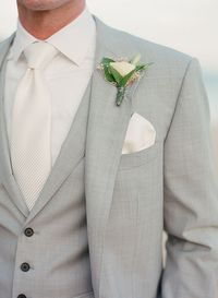 Intimate Los Cabos Destination Wedding, Groom's Ivory Tie and Boutonniere   Brides.com