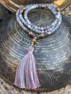 Mala necklace made ​​of 108, 6 mm - 0.236 inch, beautiful sun- and moonstone gemstones and decorated with hematite. Because the mala is strung on elastic this piece can also be worn as a wrist mala bracelet - look4treasures on Etsy