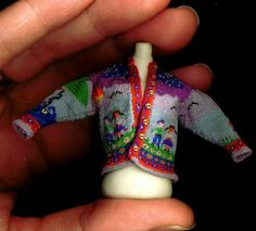 This is hand knit in 1:12 scale.   Artisan Althea Crome.