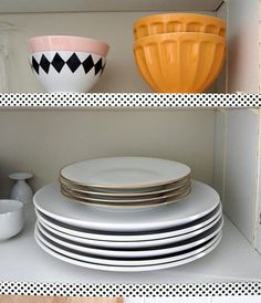 Looking for a super easy and totally renter-friendly way to spruce up your kitchen? For a little bit of patterned fun, Lela of the German blog Vorstellung von Schön applied a strip of black-and-white polka dot washi tape to the outside edge of her cabinet shelves. The effect is a nice little surprise every time she opens the cabinet doors!