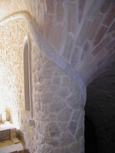 Bent stone leading into a stairway with a boveda brick ceiling done by Escobedo Construction's Masonry Craftsmen Custom Home Builders, Custom Homes, Tuscan Style Homes, Stone Masonry, Stairways, Ceilings, Craftsman, Brick, This Is Us