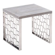 Armen Living Skyline Grey wash End Table in Brushed Stainless Steel finish. High on luxury, the Armen Living Skyline contemporary end table is the ultimate in suave sophistication, abundant versatility and classy metropolitan design. The end table's geometric laser-cut brushed stainless base is accentuated further with its Grey wash hardwood table top finish provides an interesting contrast, the mix of materials and finishes included in the table allows it to fit in with home décor. It's…