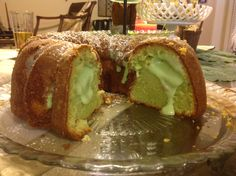 Follow your favorite pound cake recipe and add a box of Pistachio Jello Pudding to the mix along with some pistachio nuts. Pour 3/4 of the batter in your Bundt and layer one box of prepared pudding then the 1/3 reserved batter. Bake according to your recipe of choice. I added a few drops of green food coloring to brighten the green.