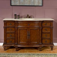 The Victorian design of this single sink vanity features ample storage room and beautiful columns. The stone top with a slight leading front creates graceful lines and a subtle depth. This vanity surely will be a great focal point of your bathroom.