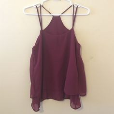NWOT Maroon chiffon top Bought online and never worn strappy chiffon top in a beautiful maroon. Layered fabric at the bottom adds a flirty touch. Top has no tags or brand whatsoever but fits like a TTS XS Tops Tank Tops