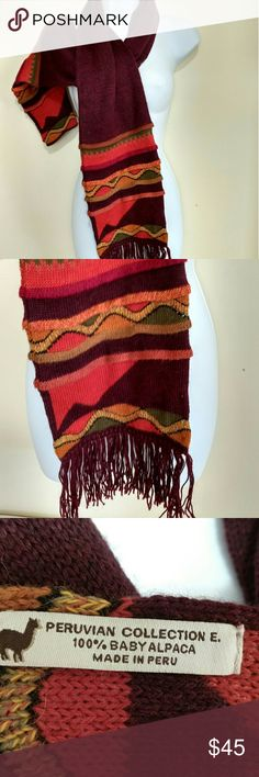 Peruvian Collection E. 100% Baby Alpaca Scarf Peruvian Collection 100% Baby Alpaca Scarf Maroonish/brown, red, green, yellow/orange colors in fun patterns at the ends of the scarf. Peruvian Collection Accessories Scarves & Wraps