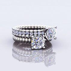 Cushion cut diamond rings by Davidson & Co. Jewels in Calgary, AB